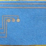 how to back-stitch musical swatch top